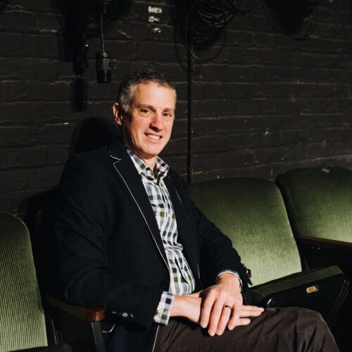 Maestro Franz sits in a theatre seat